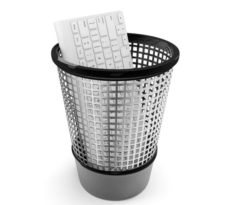 Old PC keyboard in metal trash bin royalty free stock photography
