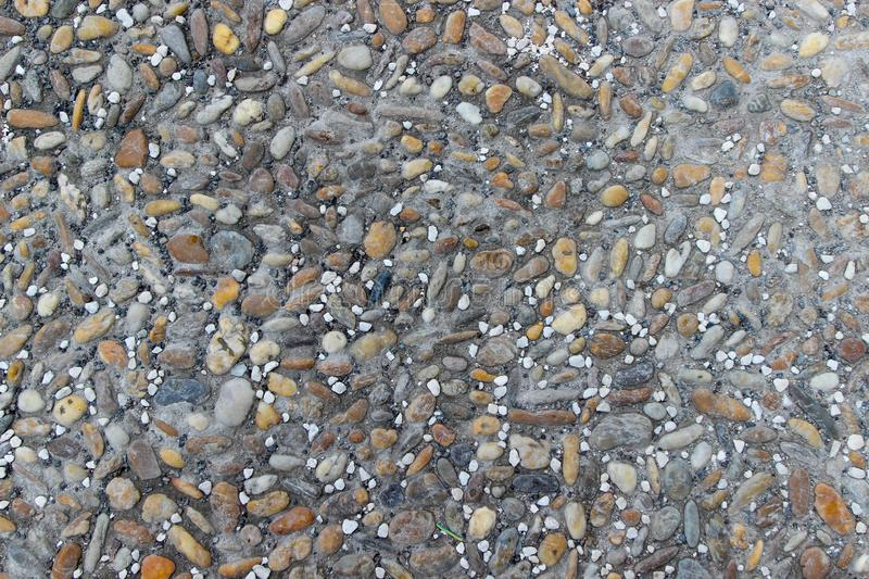 An old pebblestone road cobbled with natural stones. As a background royalty free stock image