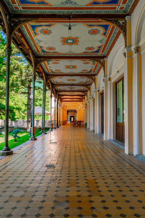 Old pedestrian corridor corridor in Herculane, Romania. Casinos, corridors, olds, architectures, abstracts, ceilings, castles, columns, decorations, cities royalty free stock photo