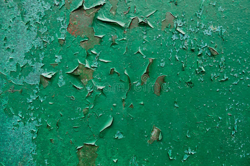 Old Peeling Paint on Rusty Metal Grunge Background. Grunge industrial background of old peeling paint on rough and rusty corroded metal surface royalty free stock photos