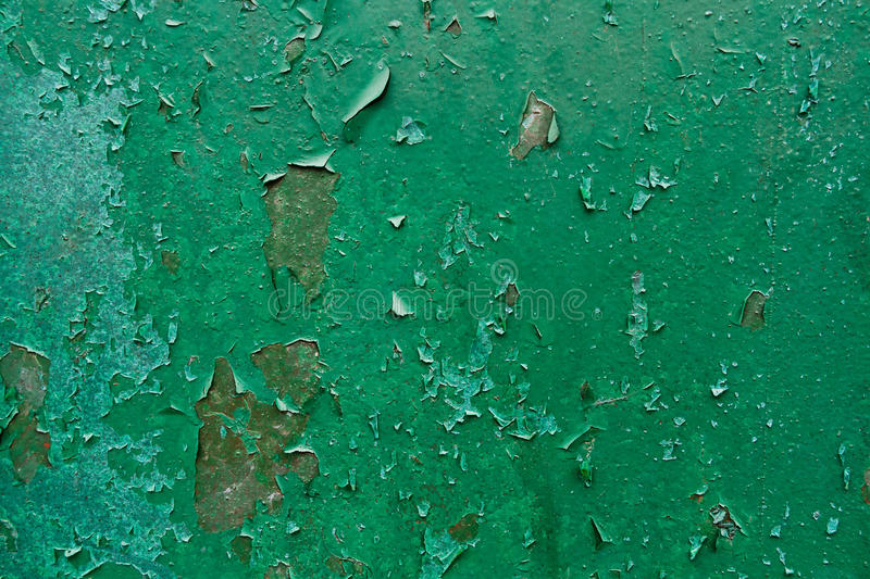 Old Peeling Paint on Rusty Metal Grunge Background. Grunge industrial background of old peeling paint on rough and rusty corroded metal surface stock images