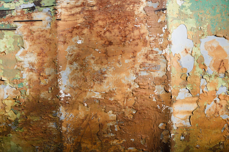 Old Peeling Paint on Rusty Metal Grunge Background. Grunge industrial background of old peeling paint on rough and rusty corroded metal surface royalty free stock photo