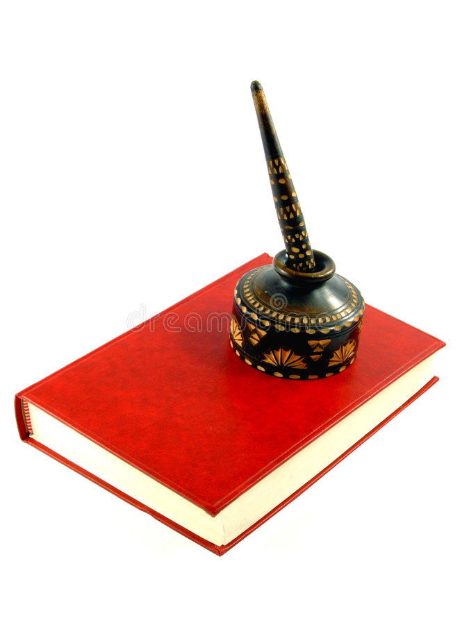 An Old Pen on a Red Book royalty free stock photography