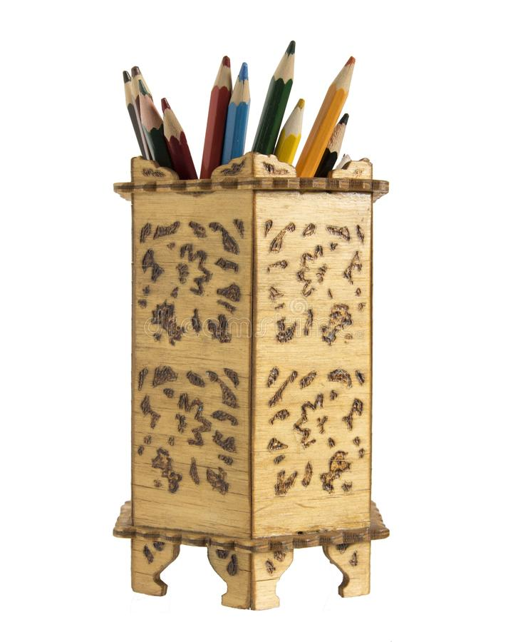 Old pencil holder. Wooden box for pencils. Colour pencils royalty free stock photo