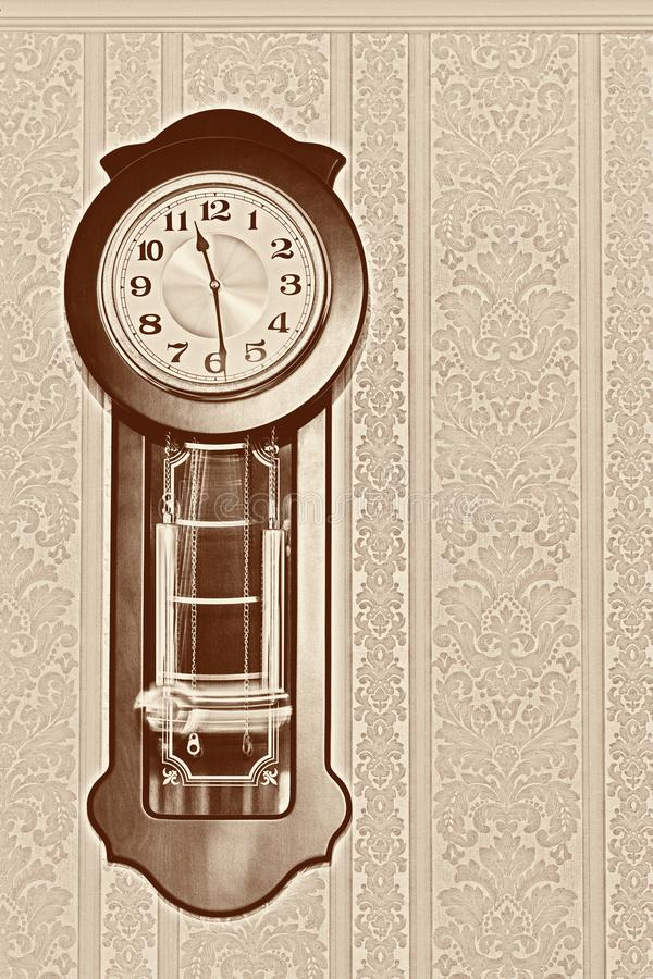 Old pendulum clock. Wall pendulum clock with the fight in the old style stock illustration