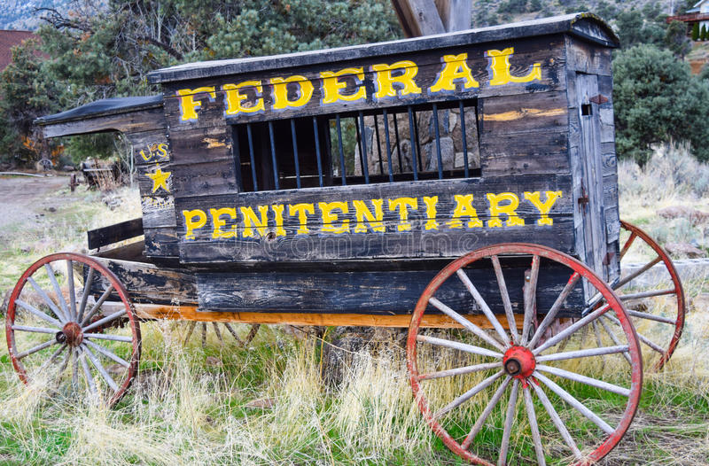 Old Penitentiary Wagon. In the pines stock photo