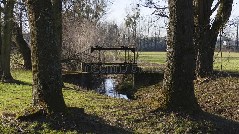 Old penstock, in the public park, with castle Favorite, Foerch stock image