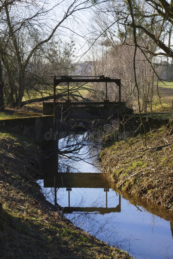 Old penstock, in the public park, with castle Favorite, Foerch stock photography