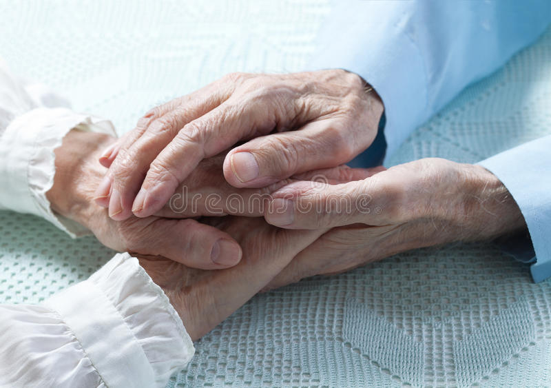 Old people holding hands closeup. Elderly couple. stock images