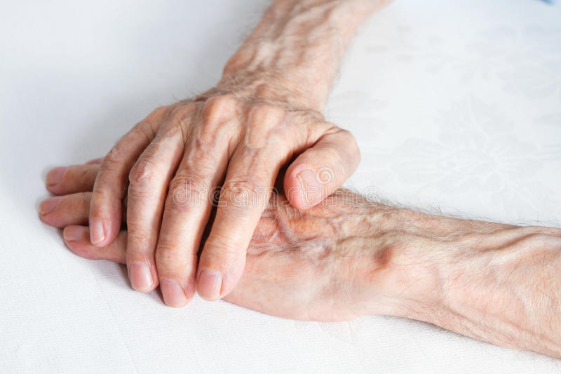 Old people holding hands. Closeup. See my other works in portfolio stock images