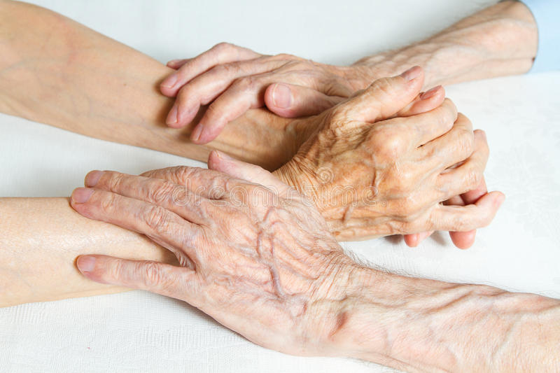 Old people holding hands. Closeup. See my other works in portfolio stock photos