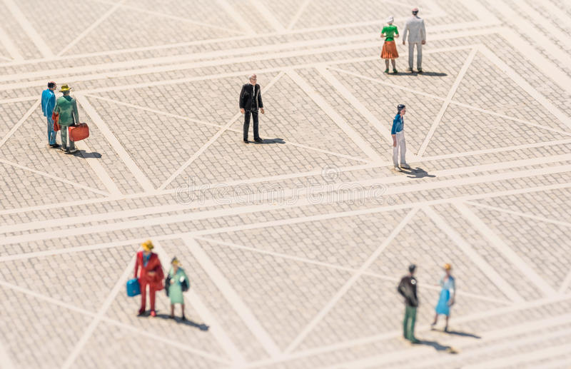 Old person miniature - Lonely man standing lost in the crowd. Old person miniature - Lonely man standing lost in the middle of a generic square with normal royalty free stock photo