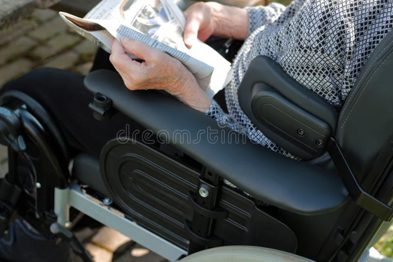 Old person in a wheelchair stock image