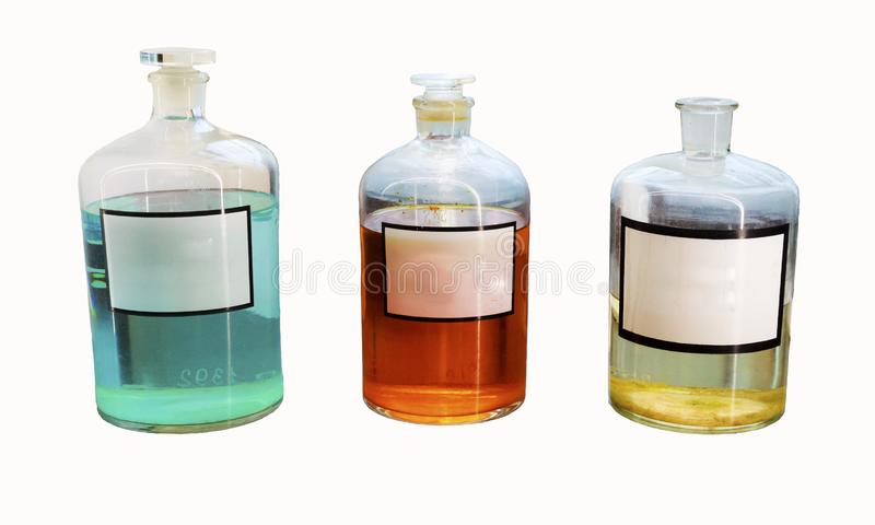 Old pharmaceutical bottles mock up isolated. Vintage chemistry flasks. Apothecary bottles mock up with colorful liquid. Vintage pharmacy glassware isolated on royalty free stock image