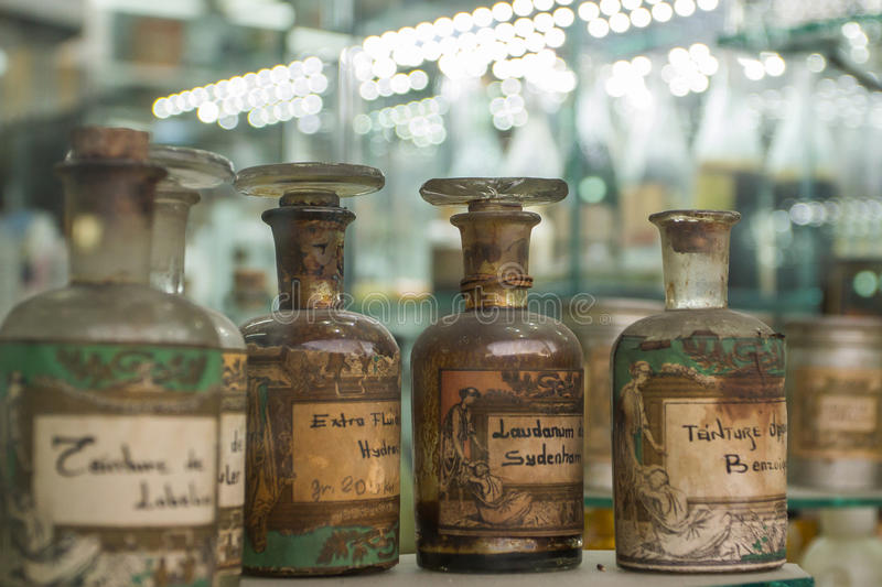 Old Pharmacy Bottles. Old pharmacy cabinet with drugs in glass bottles royalty free stock photos