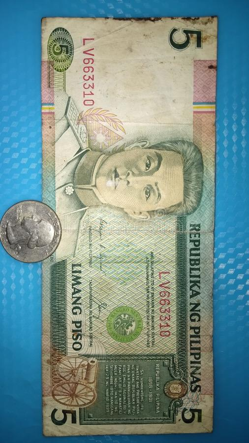 Old philippine five peso 1989 and old us coin dollar 1949 stock photos
