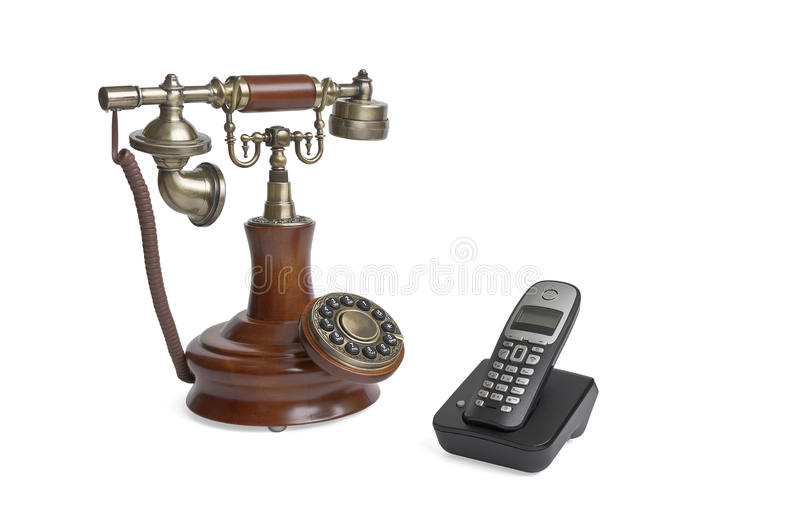 Retro phone and modern phone. Isolated on white background royalty free stock images