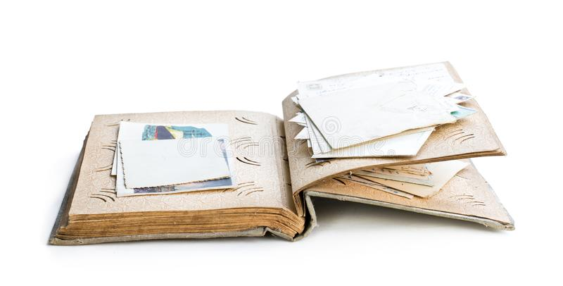 Old photo album with photos and post cards isolated on white royalty free stock photography