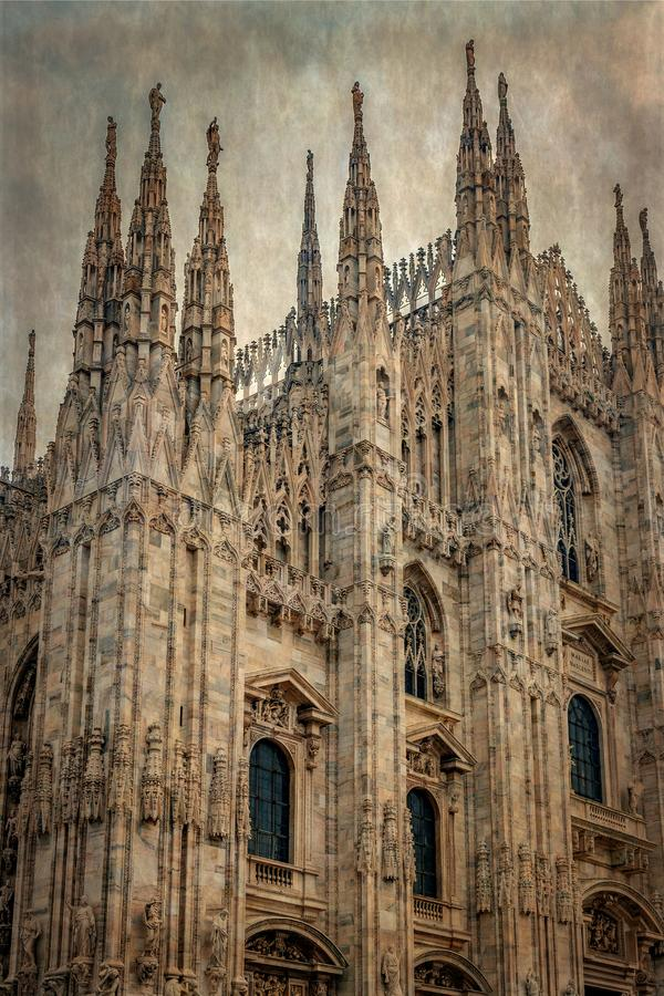 Old photo with architectonic details from the famous Milan Cathedral stock image