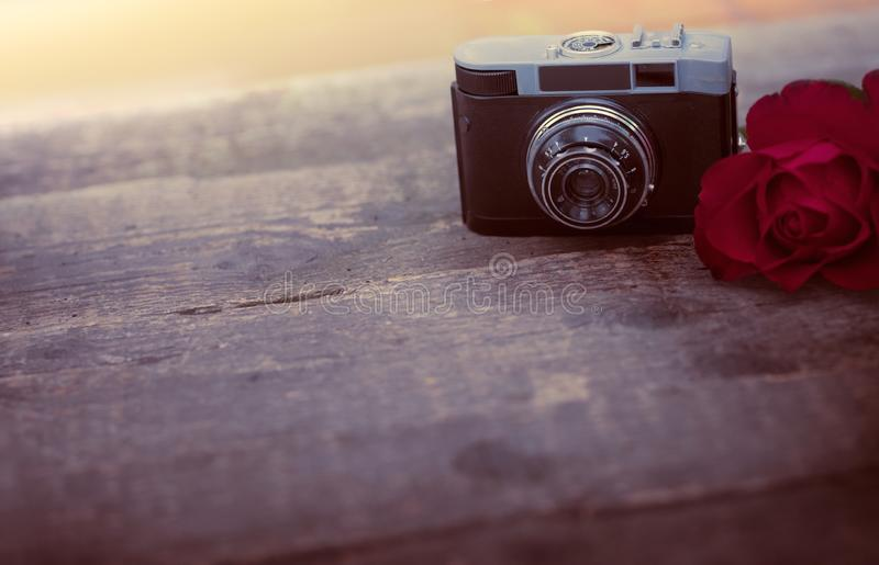 Old photo camera on wooden desk, space for text royalty free stock photo