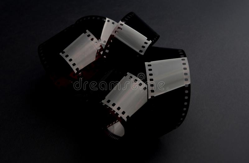 Old photo film negative. Old camera roll film on the black background. Photography concept royalty free stock photos
