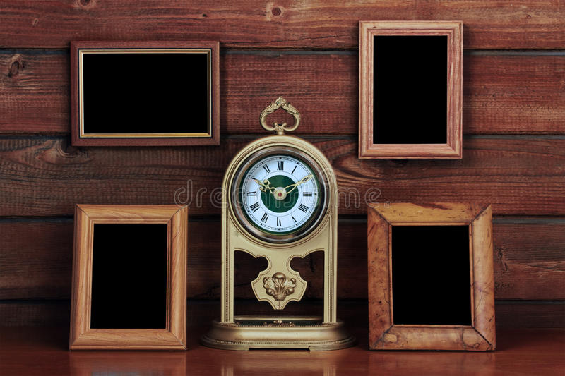 Old photo frames and antique clock royalty free stock images