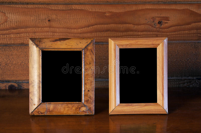 Old photo frames on table stock image. Image of indoors - 10969035