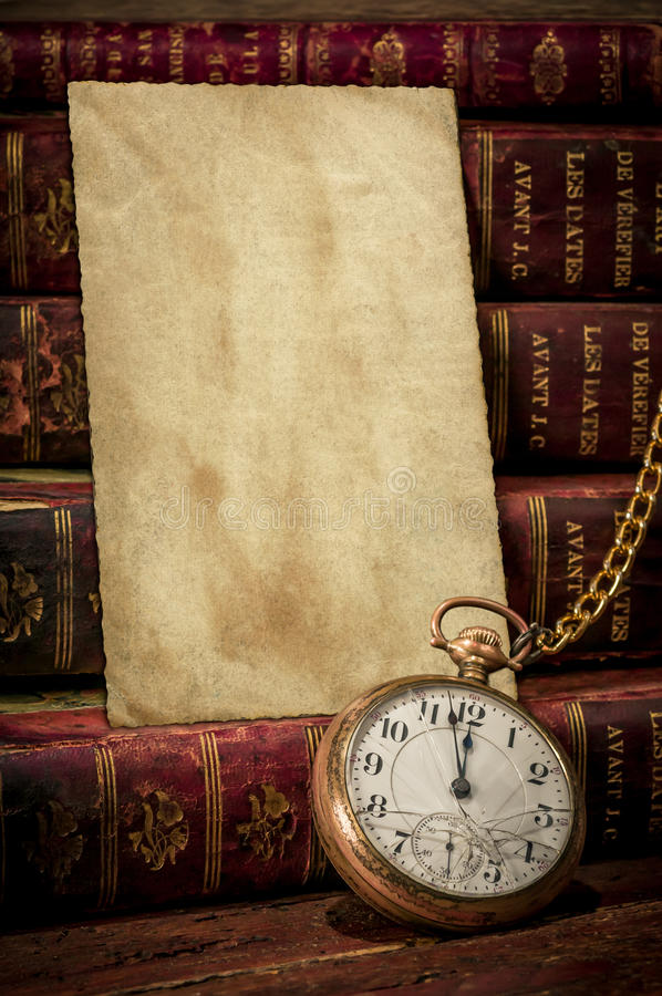 Old photo paper texture, pocket watch and books royalty free stock photography