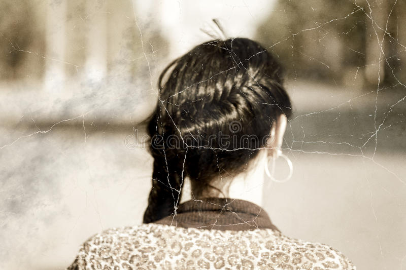 Old photo stylized headshot of a braided brunette women from back royalty free stock photography