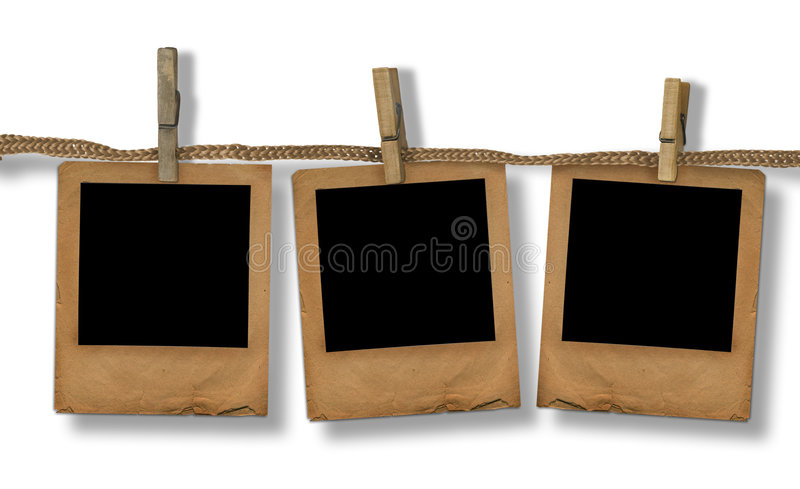 Old photoframes are hanging in the row stock photo
