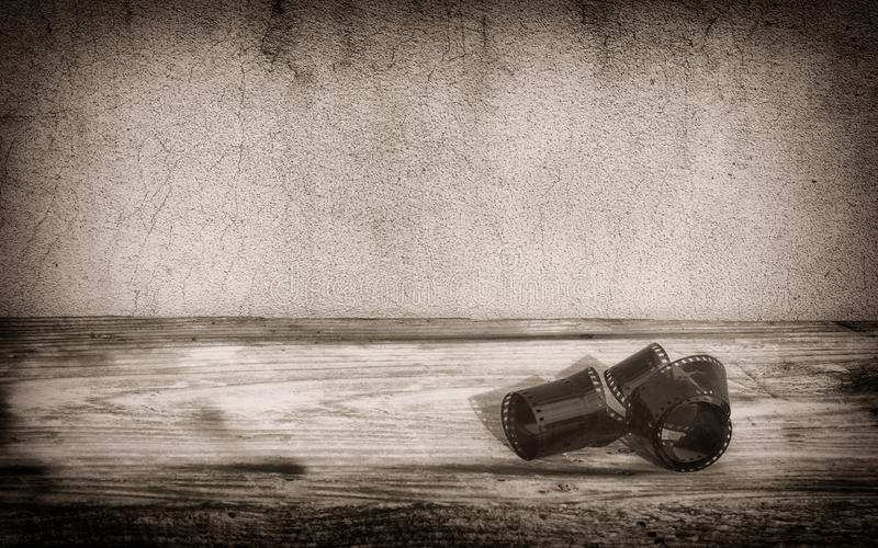 Old photographic film roll on boards background royalty free stock photo