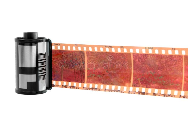 Old photographic 35 mm film, isolated. Old photographic 35 mm film with roll. Isolated on white background stock photos
