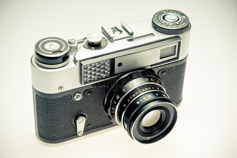 Old photography camera in vintage style. Over light background stock photos