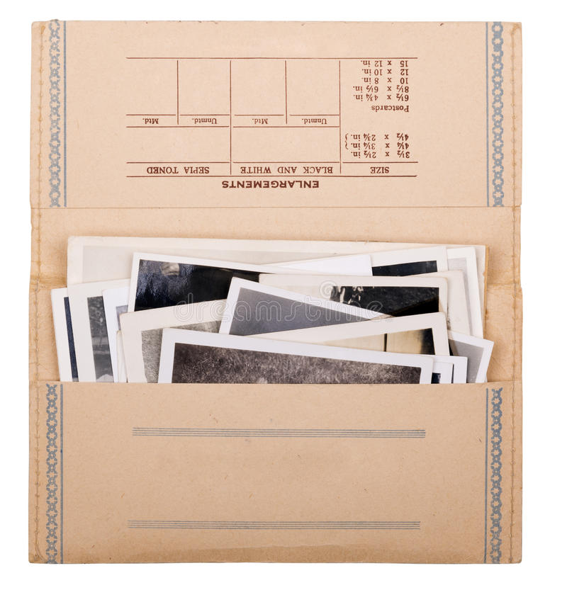 Old Photos. Old black and white photos in a vintage photo wallet isolated on white stock photo
