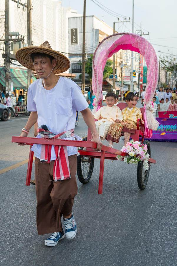 Old Phuket town festival. PHUKET, THAILAND - 07 FEB 2014: Rickshas with passenger take part in procession parade of annual old Phuket town festival royalty free stock photography