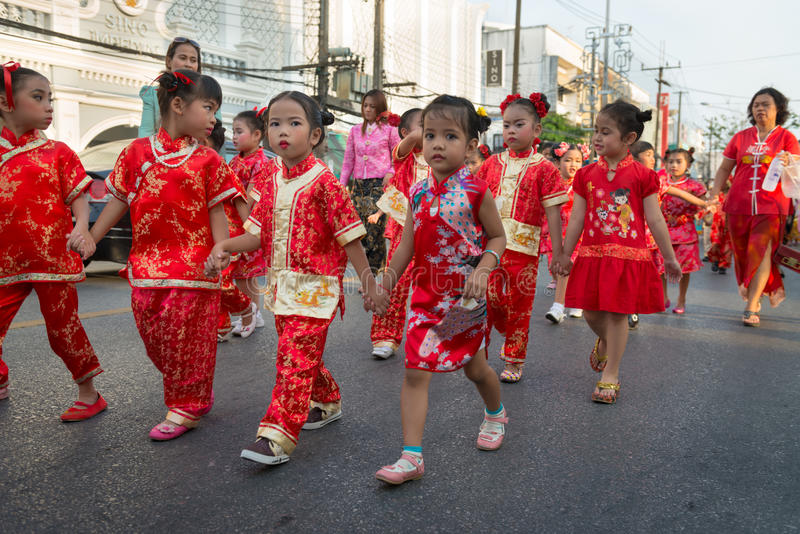 Old Phuket town festival. PHUKET, THAILAND - 07 FEB 2014: Small children take part in procession parade of annual old Phuket town festival stock photography