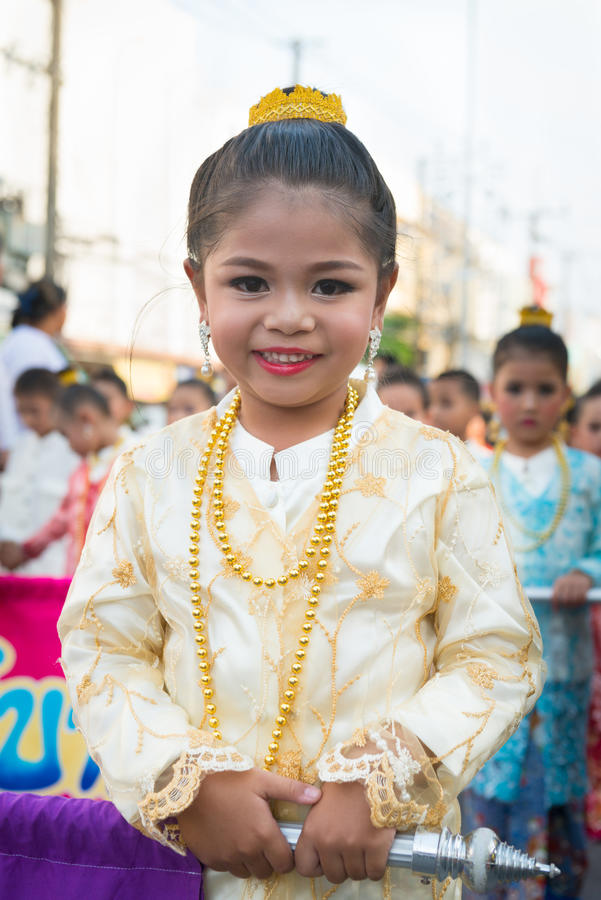 Old Phuket town festival. PHUKET, THAILAND - 07 FEB 2014: Beautiful small girl take part in procession parade of annual old Phuket town festival stock images