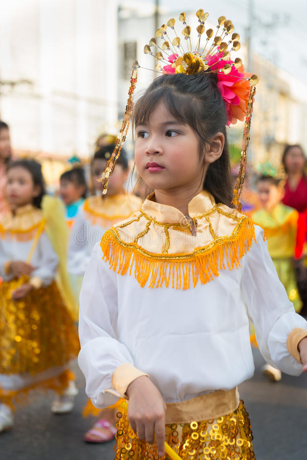 Old Phuket town festival. PHUKET, THAILAND - 07 FEB 2014: Young girl take part in procession parade of annual old Phuket town festival royalty free stock photos