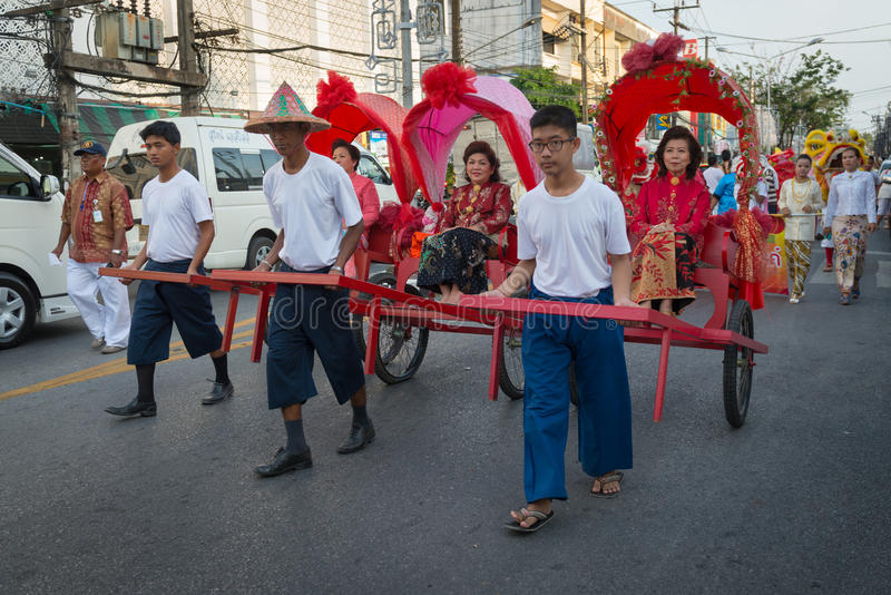 Old Phuket town festival. PHUKET, THAILAND - 07 FEB 2014: Rickshas with passenger take part in procession parade of annual old Phuket town festival stock photos