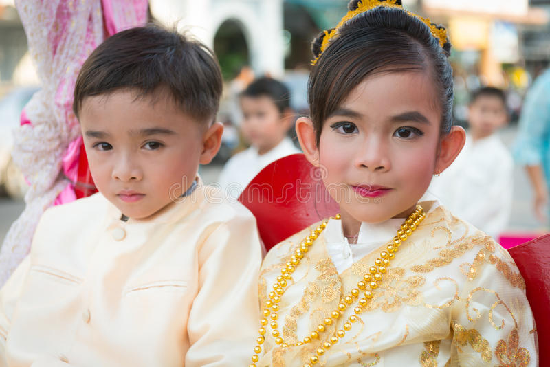 Old Phuket town festival. PHUKET, THAILAND - 07 FEB 2014: Small children take part in procession parade of annual old Phuket town festival royalty free stock photos