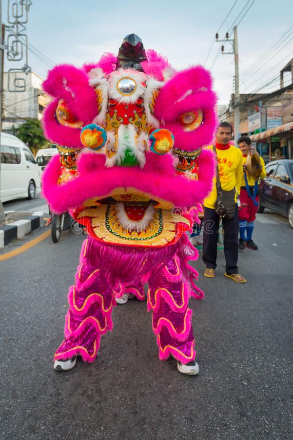 Old Phuket town festival. PHUKET, THAILAND - 07 FEB 2014: Dragon image in bright costume take part in procession parade of annual old Phuket town festival stock images