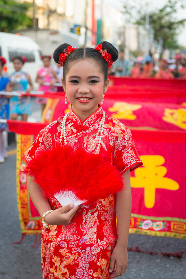 Old Phuket town festival. PHUKET, THAILAND - 07 FEB 2014: Beautiful girl take part in procession parade of annual old Phuket town festival stock photography