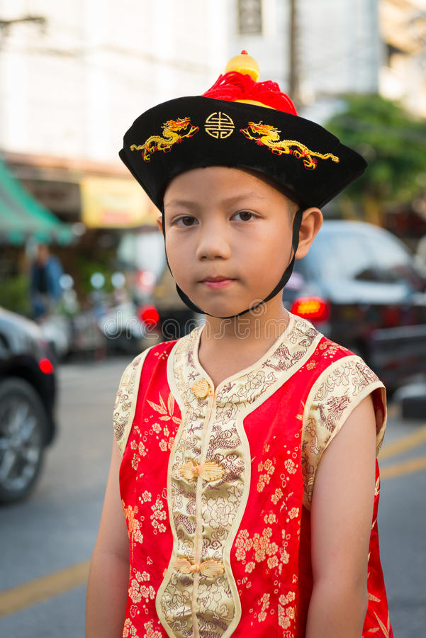 Old Phuket town festival. PHUKET, THAILAND - 07 FEB 2014: Young boy take part in procession parade of annual old Phuket town festival stock photo