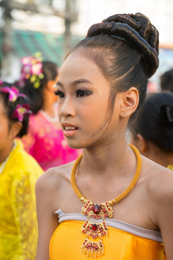 Old Phuket town festival. PHUKET, THAILAND - 07 FEB 2014: Beautiful young woman take part in procession parade of annual old Phuket town festival royalty free stock images