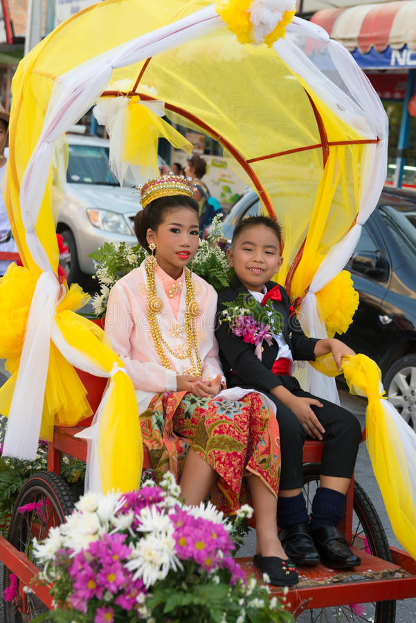 Old Phuket town festival. PHUKET, THAILAND - 07 FEB 2014: Rickshas with passenger take part in procession parade of annual old Phuket town festival royalty free stock images