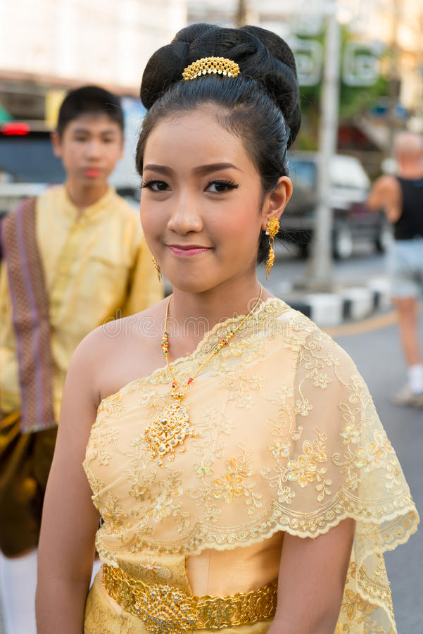 Old Phuket town festival. PHUKET, THAILAND - 07 FEB 2014: Young woman in wedding dress take part in procession parade of annual old Phuket town festival stock image