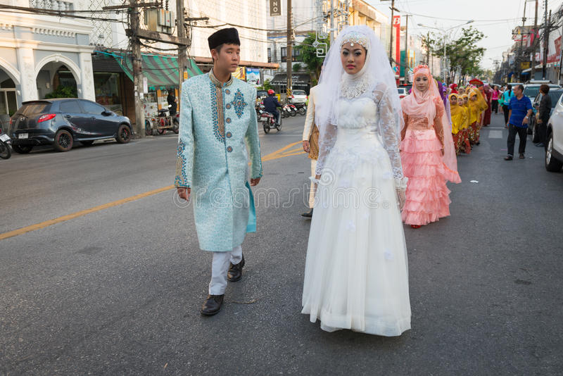 Old Phuket town festival. PHUKET, THAILAND - 07 FEB 2014: Phuket town residents in wedding dress take part in procession parade of annual old Phuket town stock images
