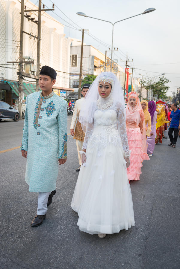 Old Phuket town festival. PHUKET, THAILAND - 07 FEB 2014: Phuket town residents in muslim wedding dress take part in procession parade of annual old Phuket town stock photo