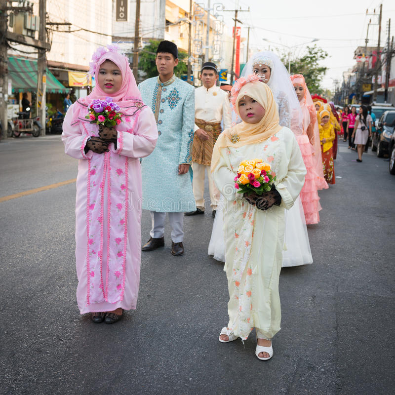 Old Phuket town festival. PHUKET, THAILAND - 07 FEB 2014: Phuket town residents in wedding dress take part in procession parade of annual old Phuket town royalty free stock photography