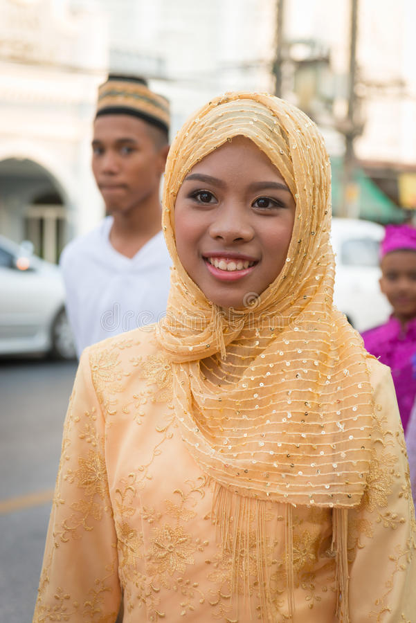 Old Phuket town festival. PHUKET, THAILAND - 07 FEB 2014: Young muslim woman take part in procession parade of annual old Phuket town festival stock photos